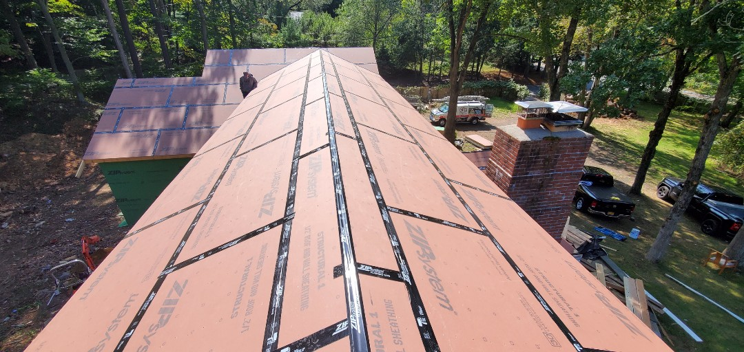 Westport, CT - New constructions roof installation, New GAF Timberline roof system in color charcoal.