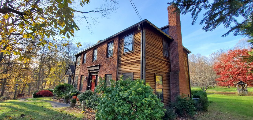 "Weston, CT - 6"" seamless gutters in k style. Color musket brown with a stainless micro mesh gutter guards."