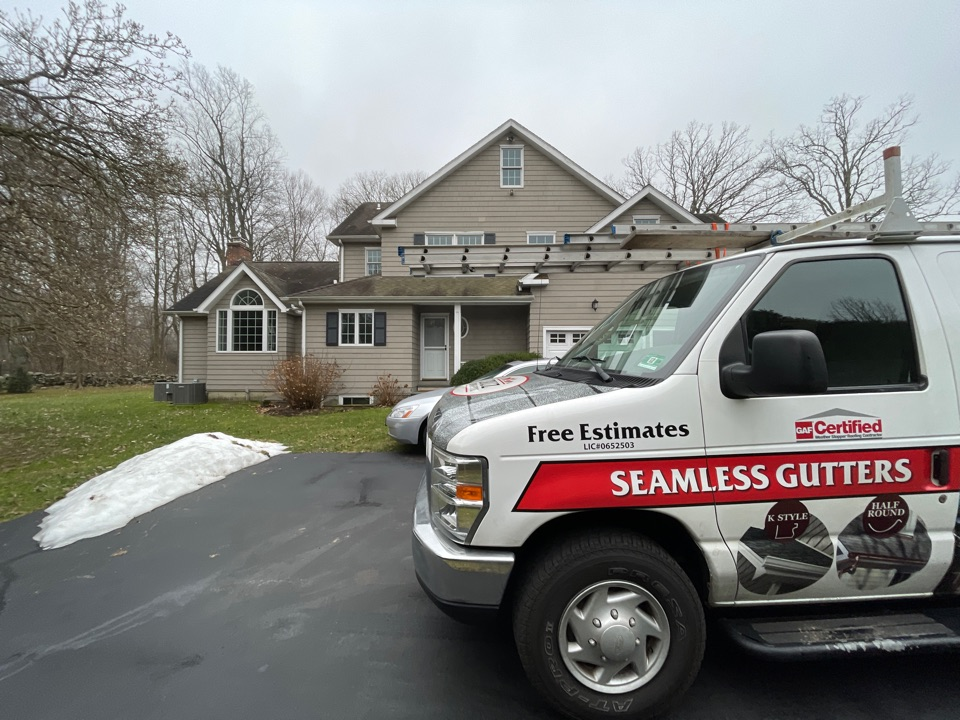 Westport, CT - Full roof replacement with new seamless gutters. Free estimates.