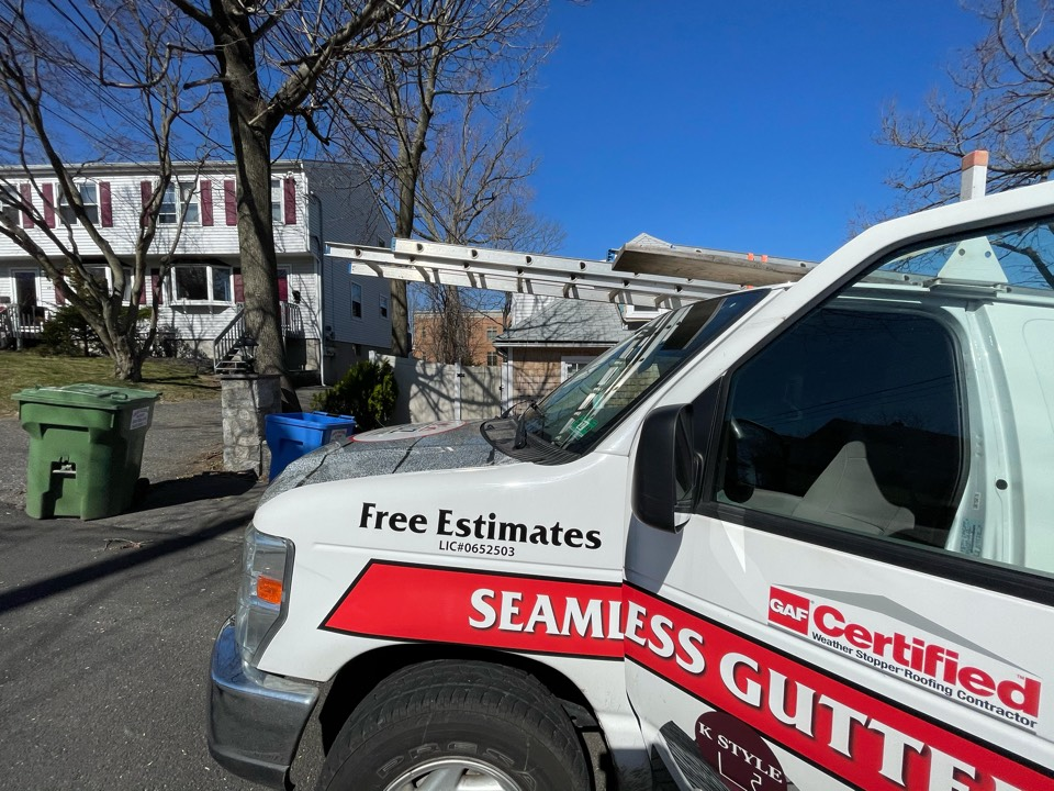Fairfield, CT - Roof replacement with seamless gutters. Free estimates.