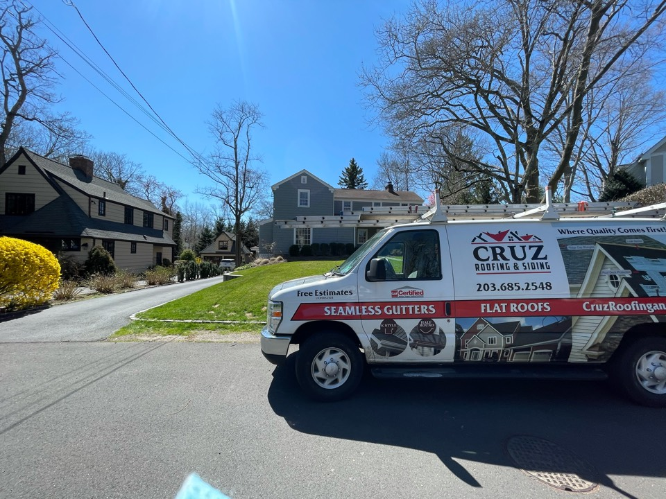 Greenwich, CT - Roof replacement with seamless gutters. Free estimates.