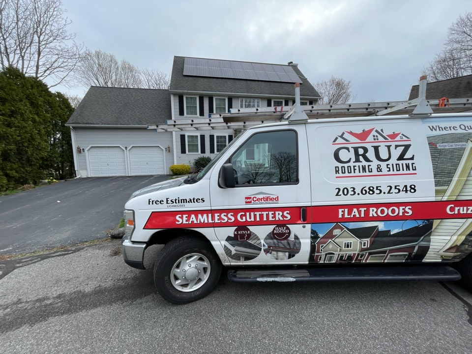 Milford, CT - Roof replacement with seamless gutters. Free estimates.