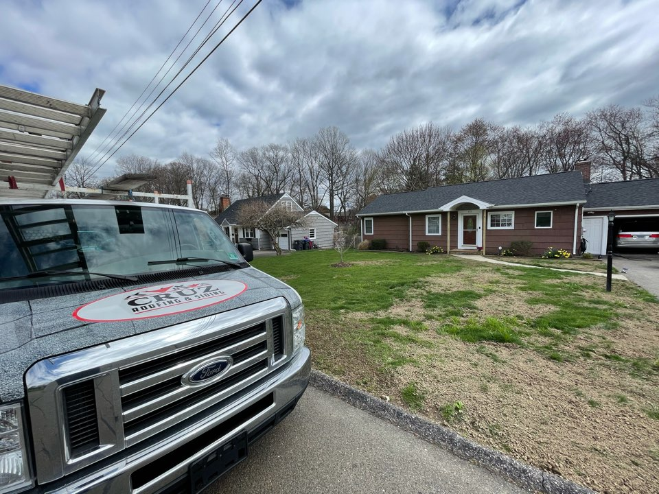 Trumbull, CT - Cedar impressions siding replacement with seamless gutters. Free estimates.