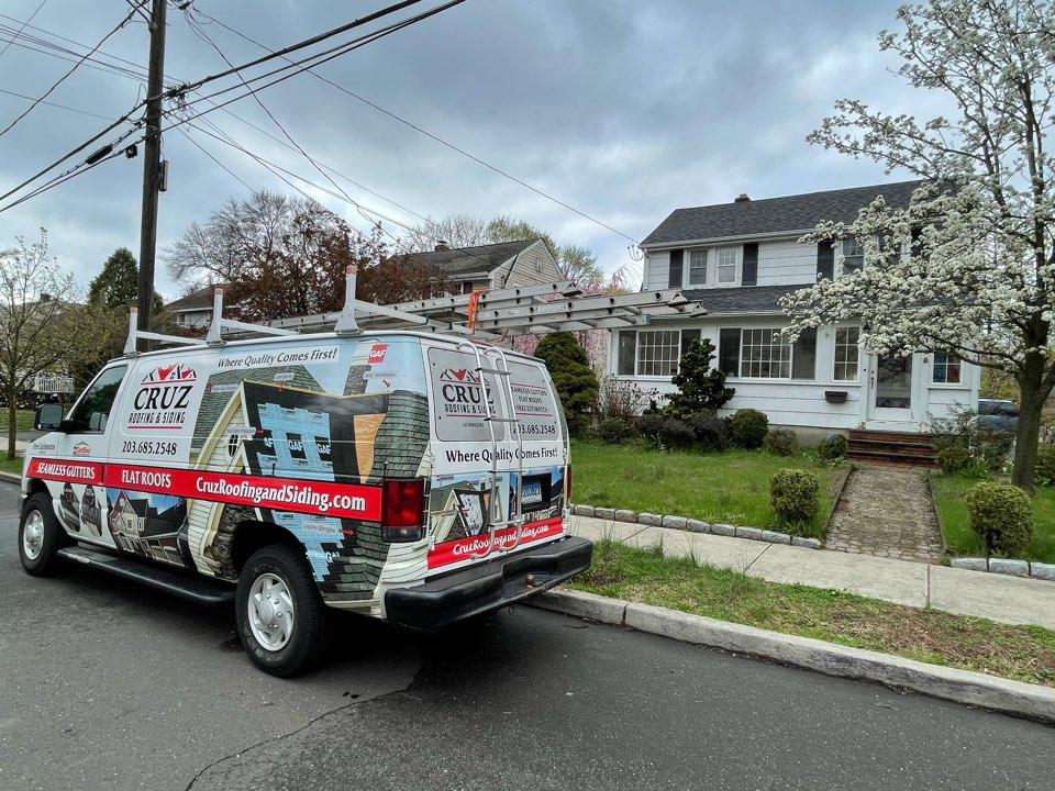 Stamford, CT - Meeting with client to go over vinyl siding replacement project.