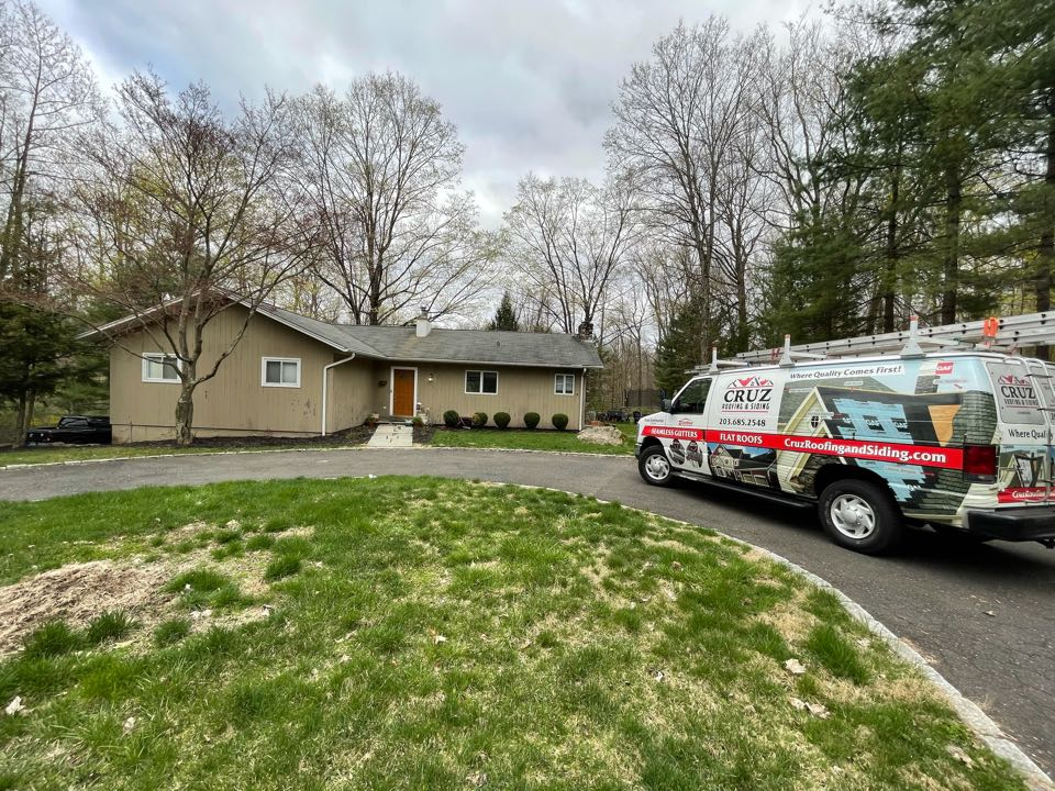 Ridgefield, CT - Roof and siding replacement.