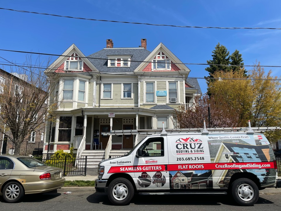 Bridgeport, CT - New owens Corning total roof protection in color harbor blue.