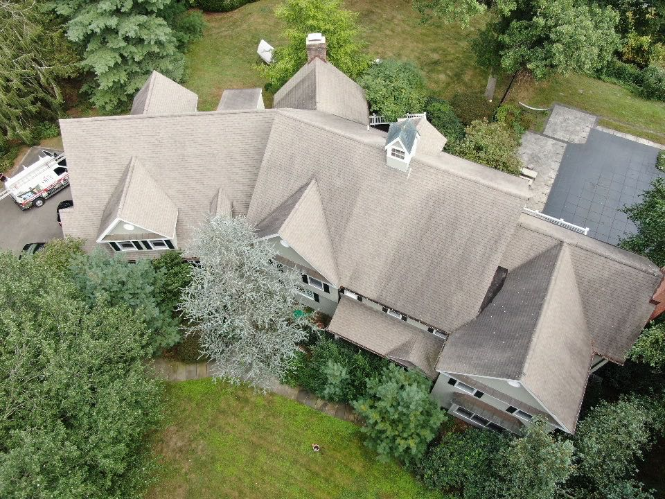 Westport, CT - Roof replacement in Westport Connecticut, Cruz Roofing and St will be installing a new Owens Corning total roof protection system in color teak.