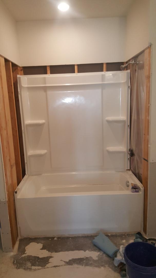 Installing 2 fiberglass tubs with walls for condominiums.  West Jordan