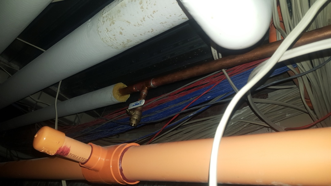 Fixing water leak in return line in red circulation system in commercial building.  Salt lake city