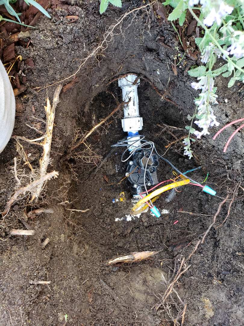 Replacing valve for sprinkler system.. Murray