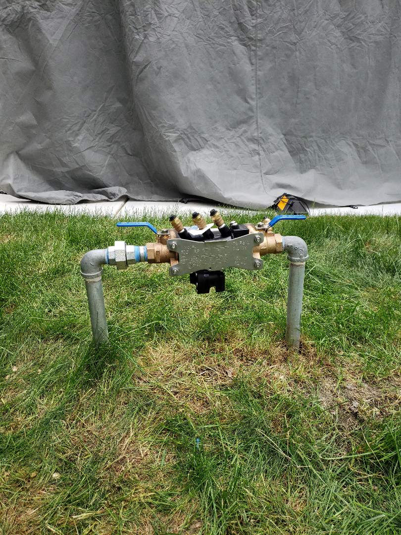 Replace a backflow preventer for irrigation system in South Salt Lake.