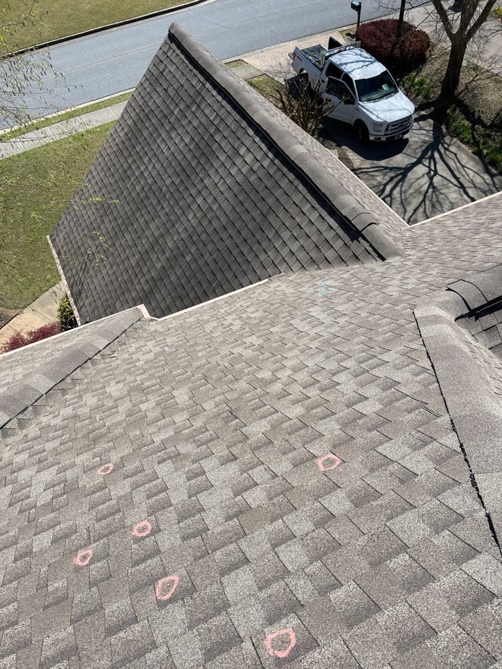 Canton, GA - Inspecting a home due to the recent hail storm. Call today for a free inspection!