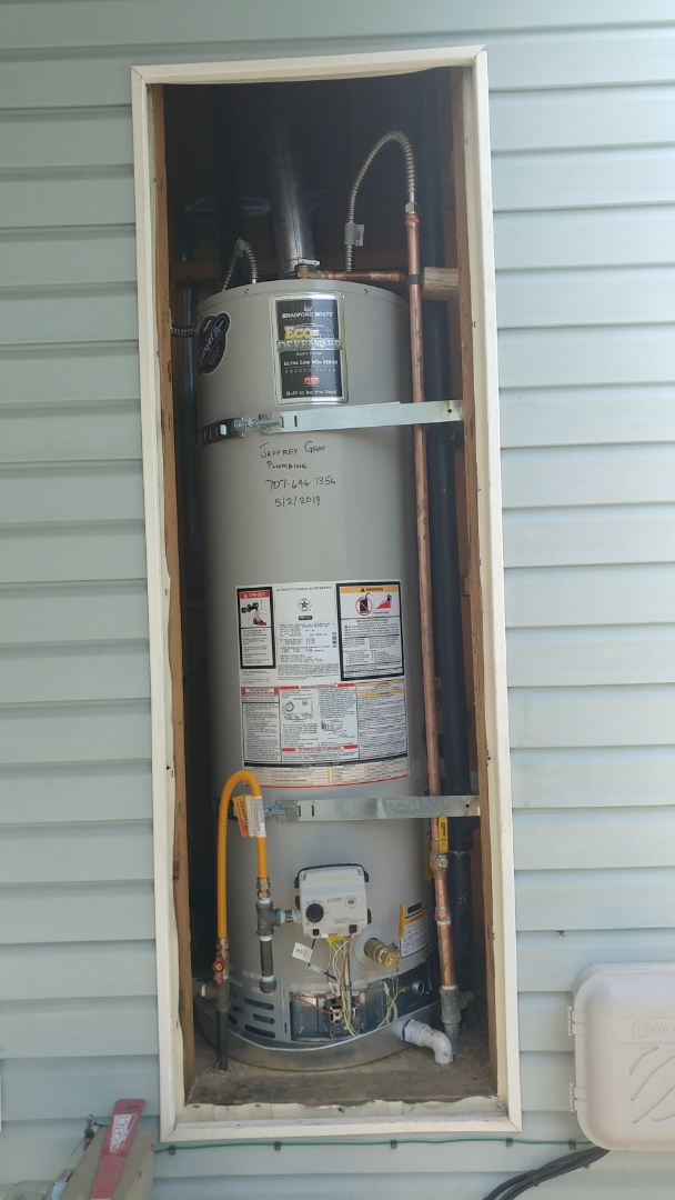 Existing water heater was installed in 1996. Installed a new 40 gallon water heater with new water flexes and earthquake straps. Ran pinky to the exterior of home.