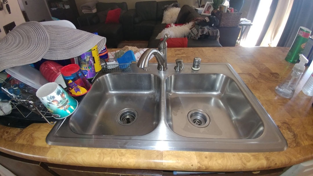Just finished installing a faucet in a kitchen sink.