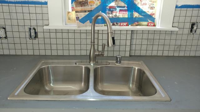 Installed stainless steel sink, under the sink plumbing and lowered the sanitary tee in the wall.