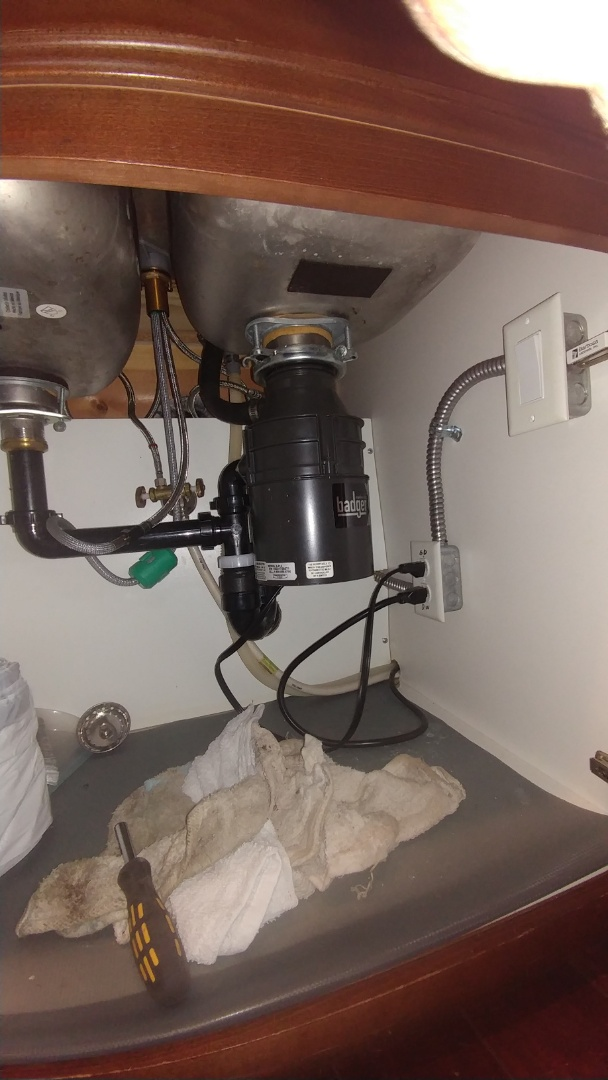 American Canyon, CA - Fix a garbage disposal by removing the debris from inside.