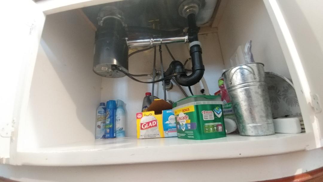 Unjammed a garbage disposal underneath a kitchen sink.