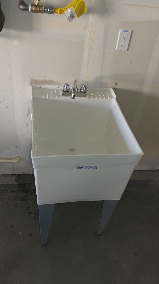 Installed customer supplied utility sink in garage.