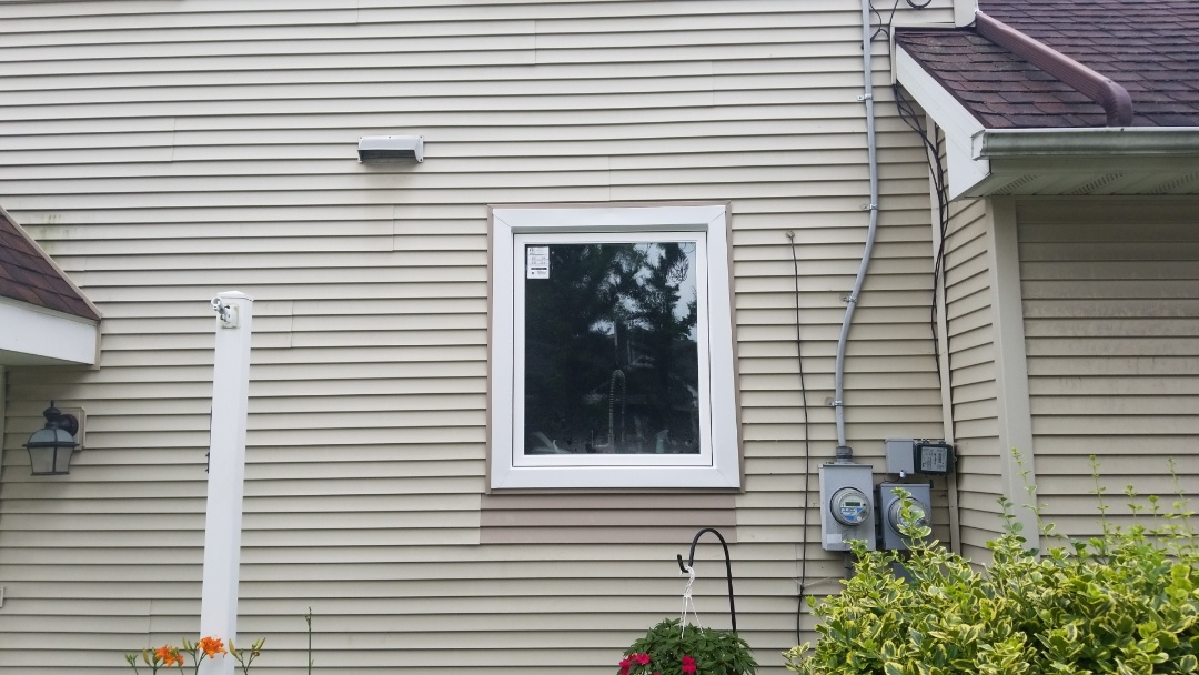 Plymouth, MI - Kearns Brothers Inc is installing new trim around a existing window for homeowner