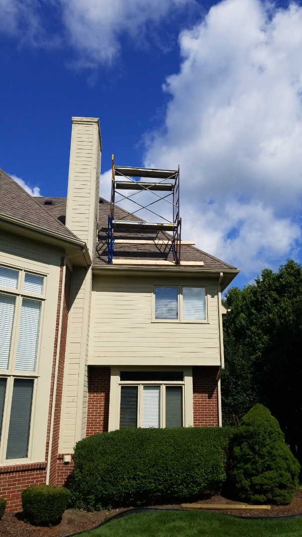 Northville, MI - Kearns Brothers Inc is set up scaffolding on roof to begin chimney work.