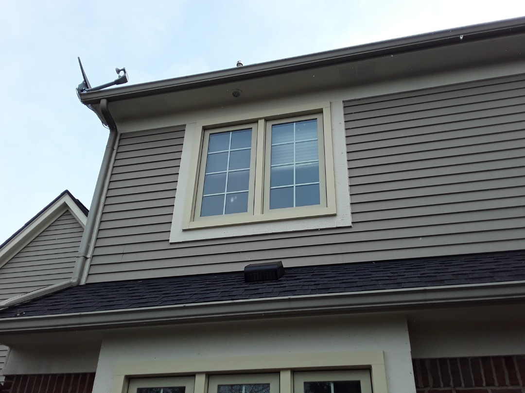 Canton, MI - Kearns Brothers Inc Installed two new roof vents and re- caulking two window ledges.