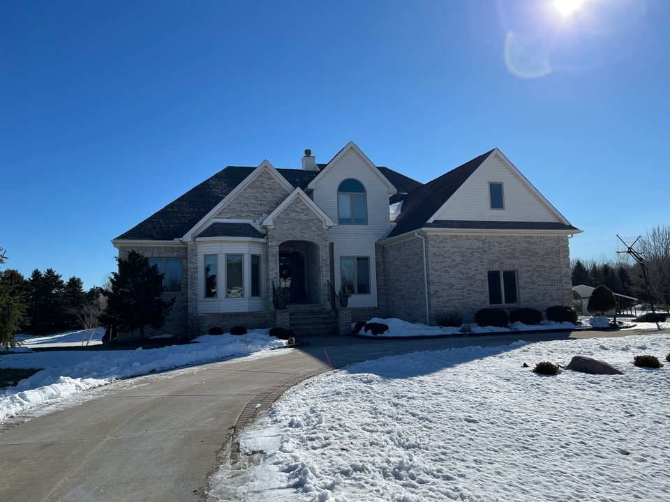 Plymouth, MI - Kearns Brothers Inc. inspecting house for possible leak and or replacement roof to a new GAF Timberline high definition Z shingles