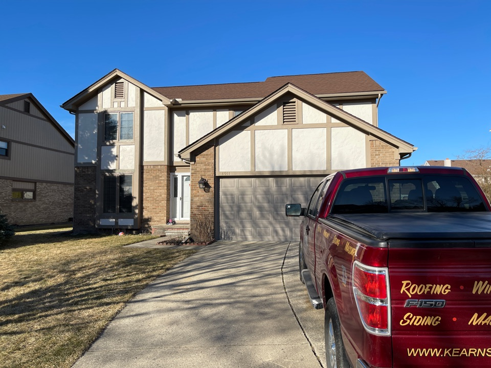 Troy, MI - Kearns Brothers Inc. to install new James Hardie stucco siding on the 1990s home