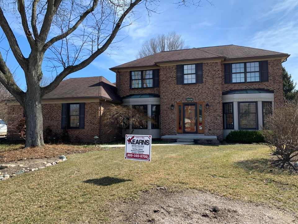 Northville, MI - Kearns Brothers Inc. do a roofing replacement to a new GAF lifetime roofing system. Installing new GAF timberline HD Z Barkwood colored shingles.