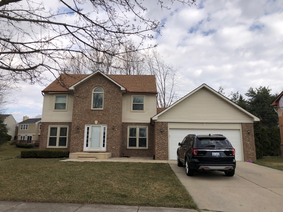 Novi, MI - Kearns Brothers Inc. Stopping by to see if we can replace these tired gutters and install some new shutters to give this colonial a fresh look!