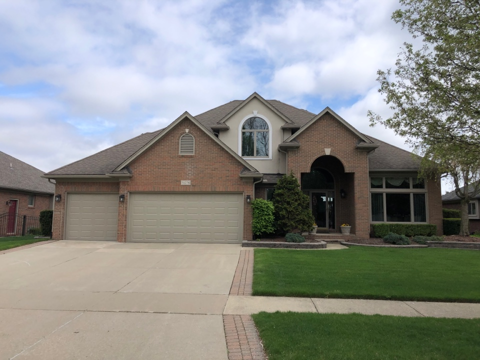Macomb, MI - Kearns Brothers Inc providing an estimate for a new GAF Roofing system.