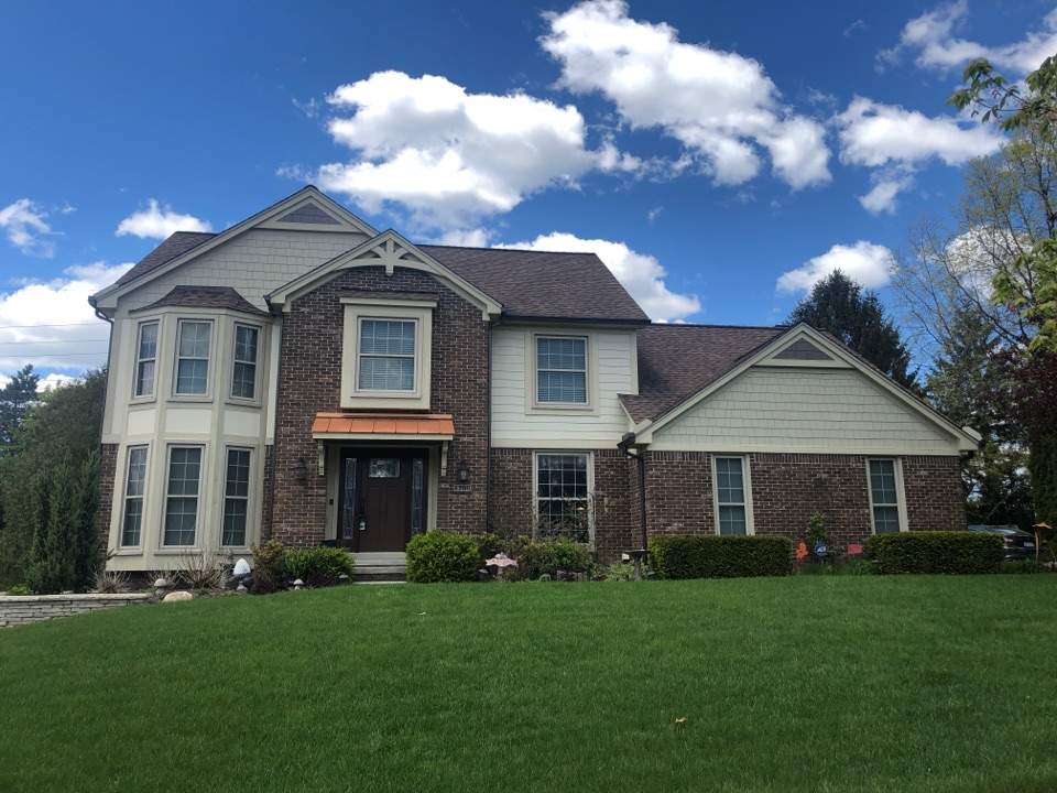 Plymouth, MI - Kearns Brothers Inc Installed GAF lifetime roofing system. Installed James Hardie fiber cement siding on the beautiful home