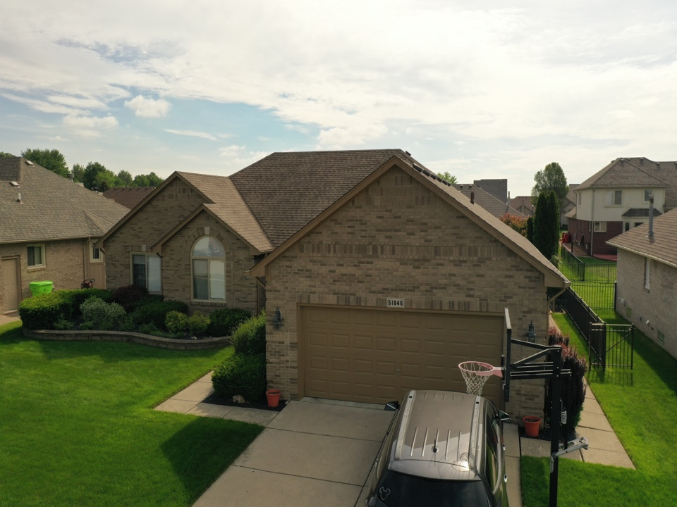 Macomb, MI - Kearns Brothers Inc Inspecting roof and providing estimate for galvanized chimney cap.