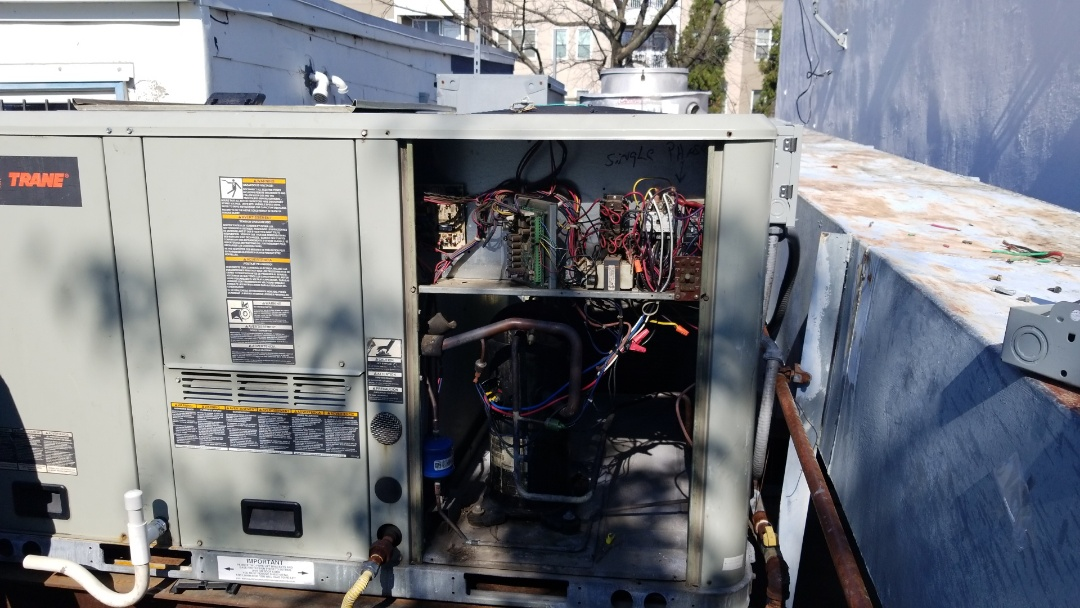 Washington, DC - Replacing the disconector on the a/c trane unit