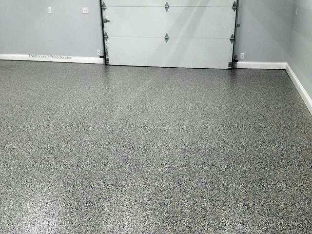Kansas City, KS - Customize your garage into a man cave with our flooring applications!! Contact us to learn more!
