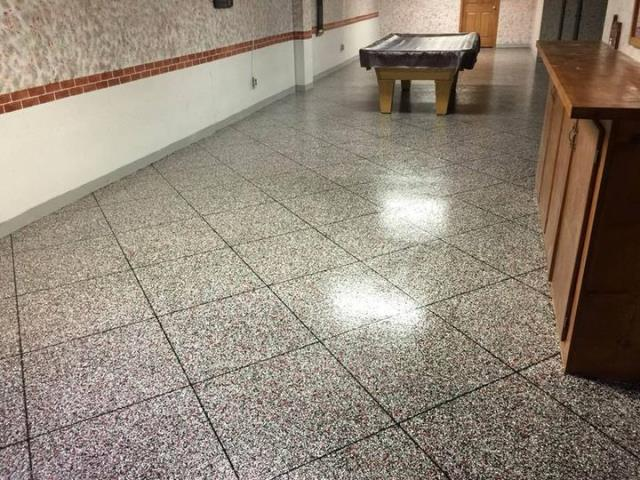 Bonner Springs, KS - Does your floor lack the ability for an easy clean-up, require a ton of maintenance care? Switch it up for an Epoxy Tile floor! Great for any room that requires durability and low maintenance like an entertainment room!!