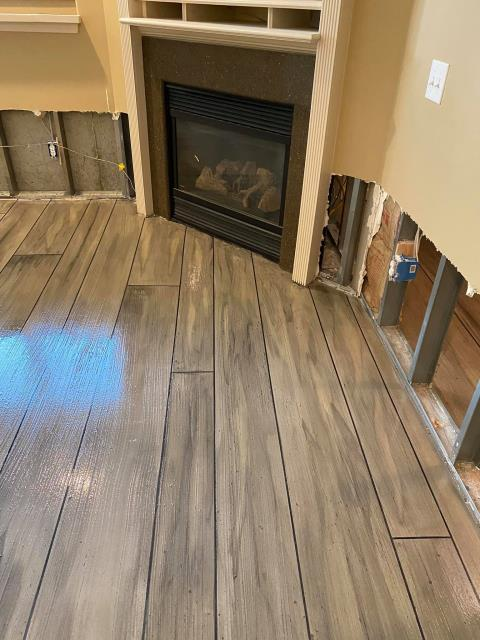 Basehor, KS - We can't wait to work with Lucas and his crew again! They were nothing but professional the entire time! We wanted wood flooring for our living room, but not the high maintenance and cleaning the floors require out of you. We called Lucas, and he recommended that we go with Rustic Concrete Wood. Now we have floors that look exactly like wood, but with less cleaning and maintenance typical hardwood floors require!! Thank you, Speakman Coatings, for a beautiful new living room floor!! 10/10 would recommend to everyone!!