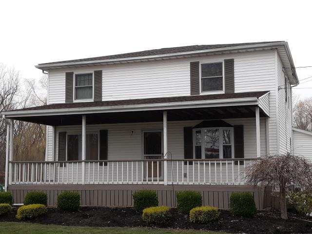 Buffalo, NY - GAF Timberline HD, Barkwood shingle replacement on upper roof section in West Seneca