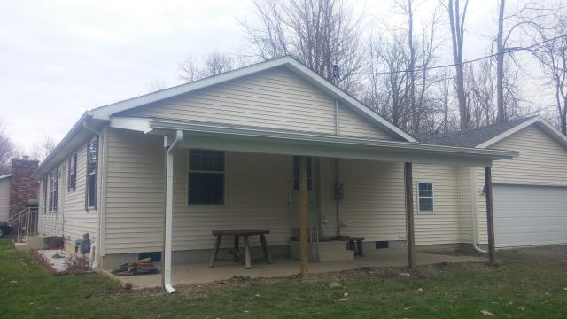 Angola, NY - Built a permanent awning over existing patio in Angola with soffit ceiling and new gutter