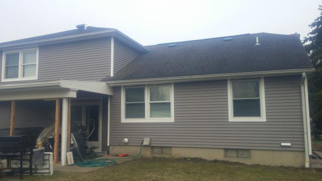 Orchard Park, NY - Removed old siding and installed new Alside Odyssey Plus vinyl siding in Storm in Orchard Park