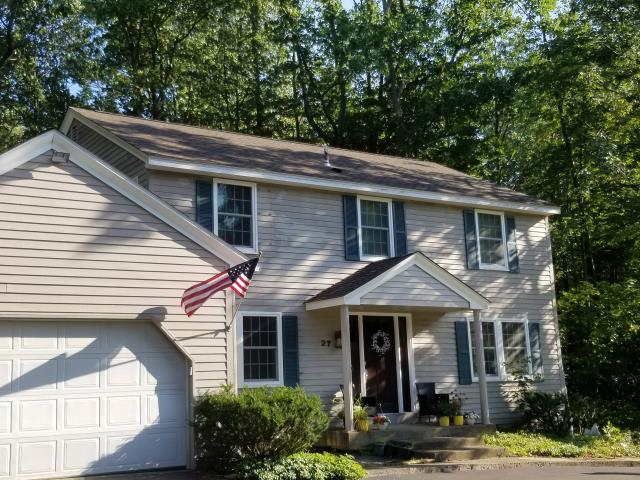 Orchard Park, NY - Completed a full roof replacement using GAF Timberline Barkwood and installed gutter system.