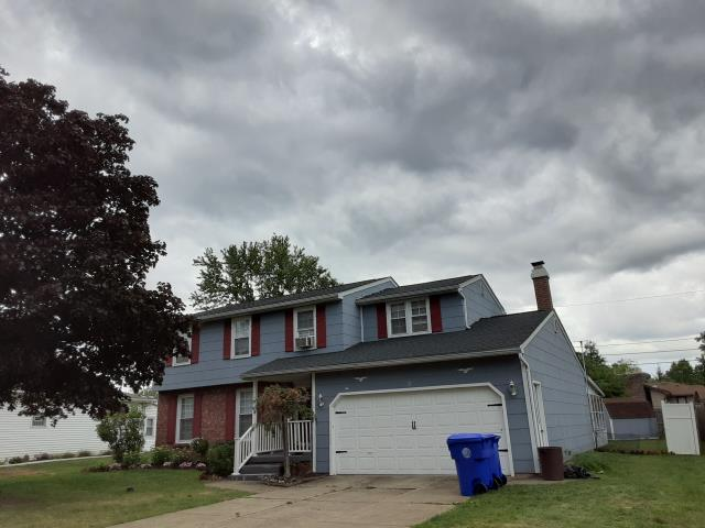 West Seneca, NY - This complete roof replacement followed extensive wind damage to the previous roofing due to age.
