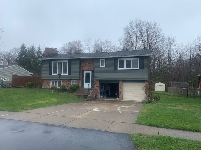 Lake View, NY - This home got a complete exterior makeover with a full roof replacement using GAF Timberline HDZ shingles in Charcoal and updated vinyl siding in a beautiful Deep Moss.