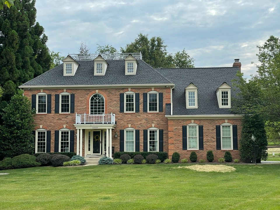 Reisterstown, MD - A beautiful new Timberline HDZ lifetime warranted roofing system installed to GAF Golden Pledge specifications. Color charcoal. Also all new over size gutters and downspouts including lifetime warranted Leafree gutter protection.