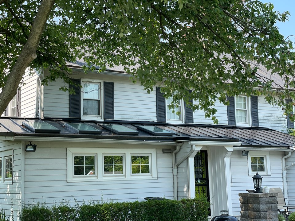 Phoenix, MD - New standing seam metal roof, skylights, epdm roof and new shingle roof.