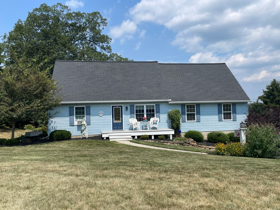 Manchester, MD - Another new GAF Timberline HDZ roof, timbertex caps and snow country ridge vent. New seamless aluminum gutters and downspouts. New lifetime Leafree gutter protection. Color of roof is charcoal.