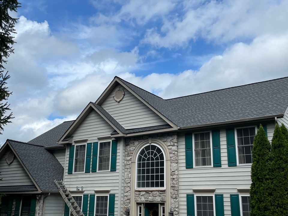 Reisterstown, MD - Another beautiful new Timberline HDZ lifetime roofing system installed to GAF golden pledge specifications color is pewter gray. All new seamless gutters and downspouts. Color is clay.