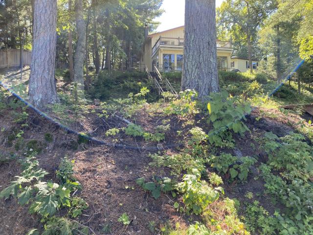 Pine River, MN - A new construction project underway. Complete design build including installing new boulder walls, new lawn, landscape beds, shoreline restoration.