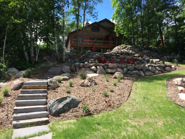Brainerd, MN - At this Gull Lake property bidding a new section of turfstone pavers on the path down the hillside. To stop some erosion, and to get more traction with their 4 wheeler.