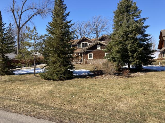 Brainerd, MN - Free consultation to add new life to old landscape beds. Changing plants adding trees and fixing drainage issues caused by snow melt and heavy rains.