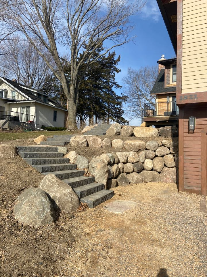 Wayzata, MN - Boulder walls and stairs for access to upper lever of house
